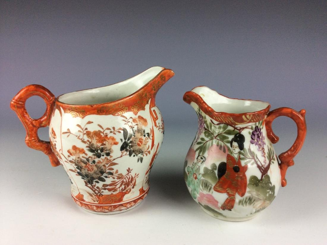 Pair of Japanese porcelain pots with flower and figures