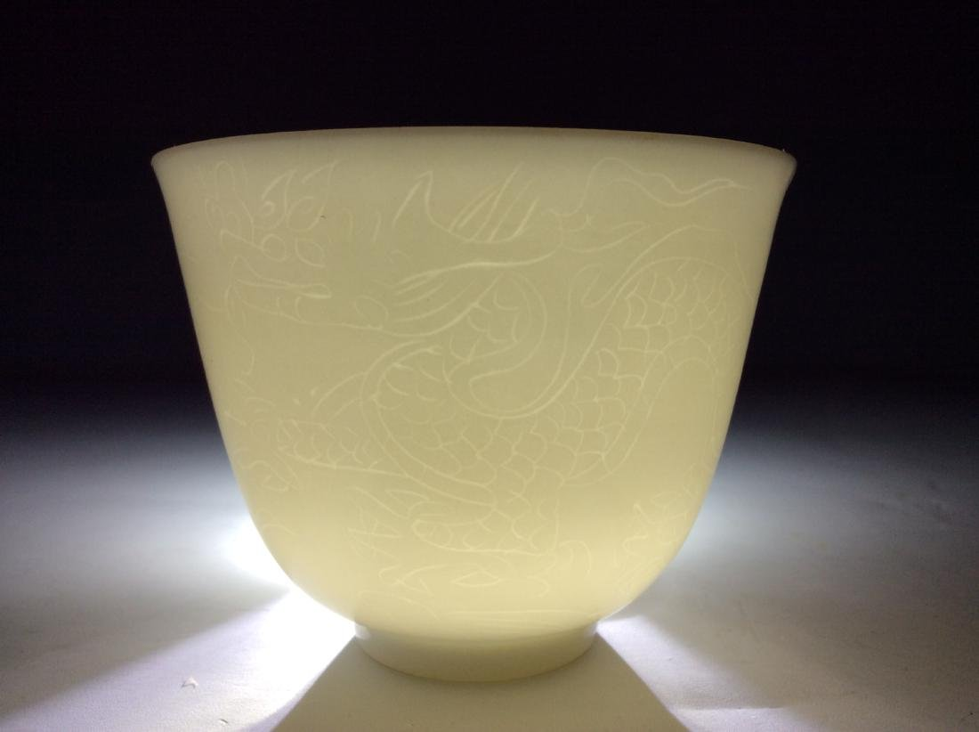 Chinese white glaze cup with engraving  dragon and