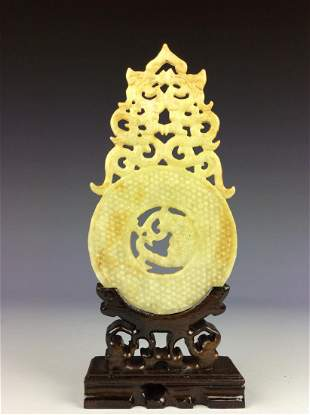 Chinese jade carved disc with decorative totem