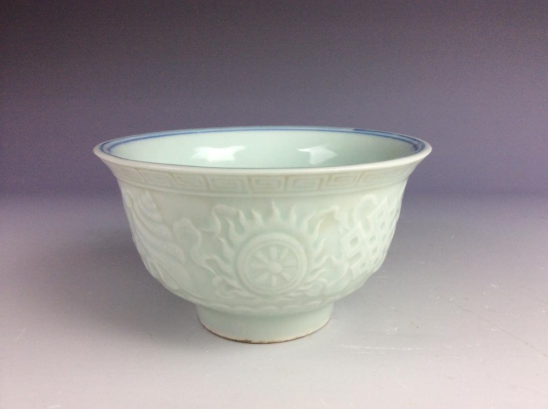 Chinese white glaze bowl with embossment of eight