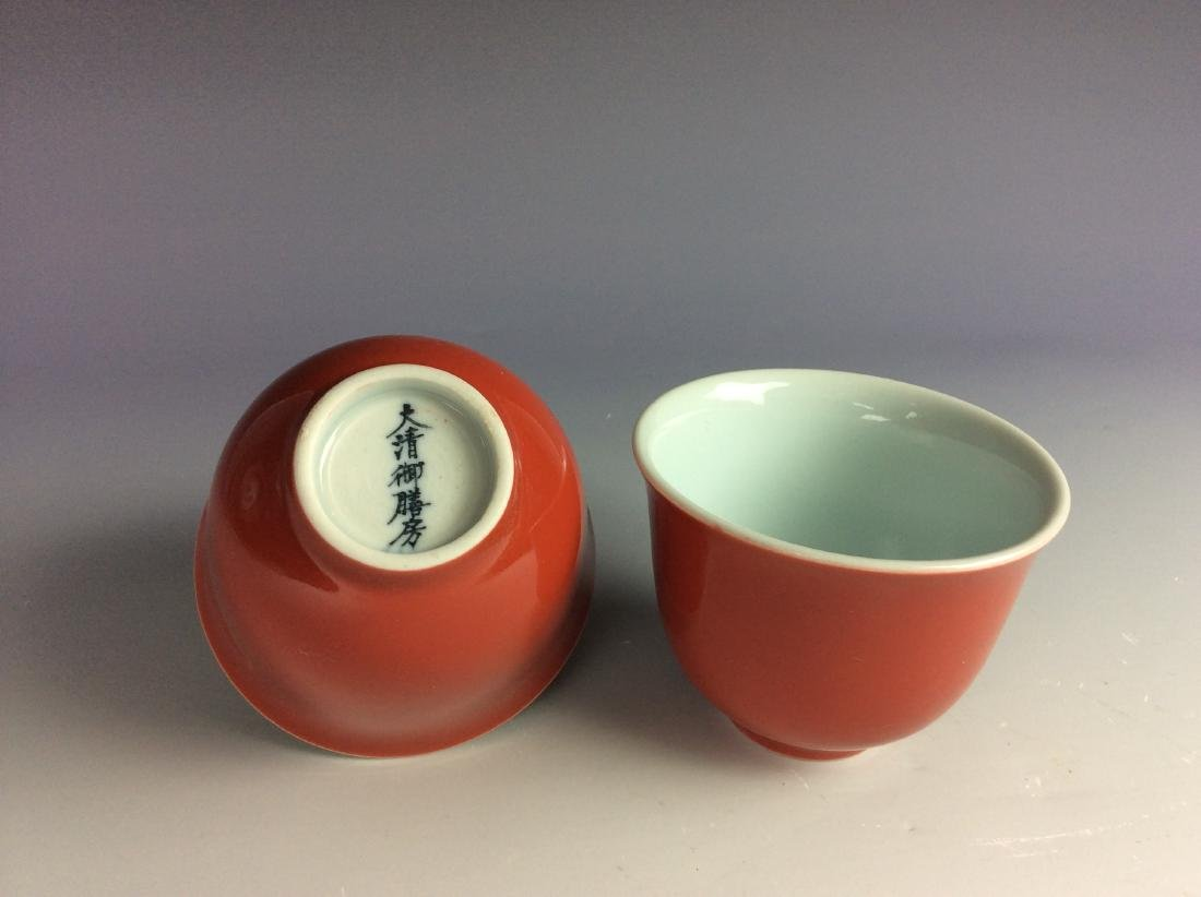 A pair of Chinese red glaze cups