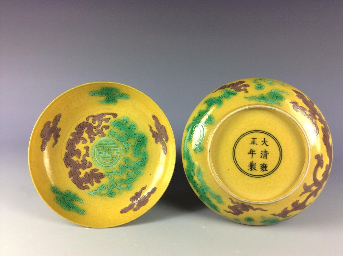 Pair of Chinese saucers with twin dragons mark on base