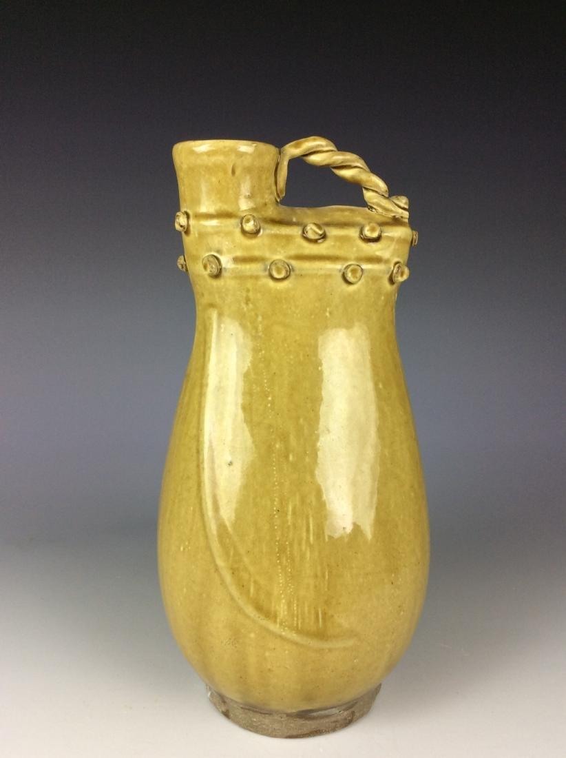 Elegant Chinese yellow glaze bagging pot