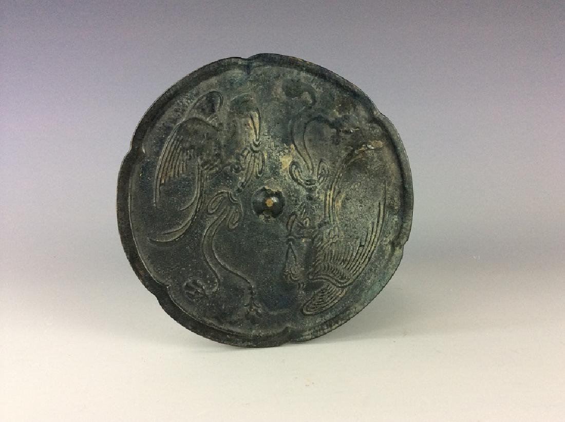 Chinese circular bronze mirror.