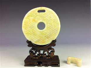 Chinese jade carved in shape of round disc and link