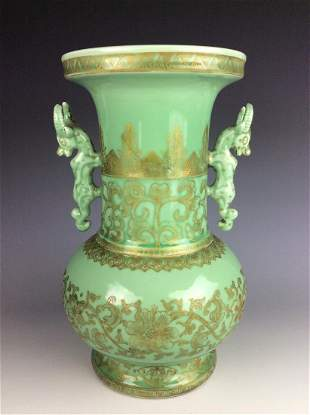 Chinese celadon vase with flower patterns and mark