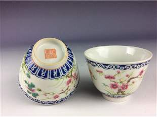 A pair of Chinese famillie rose cups with floral motif