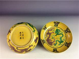 Pair of Chinese yellow glaze saucers with twin