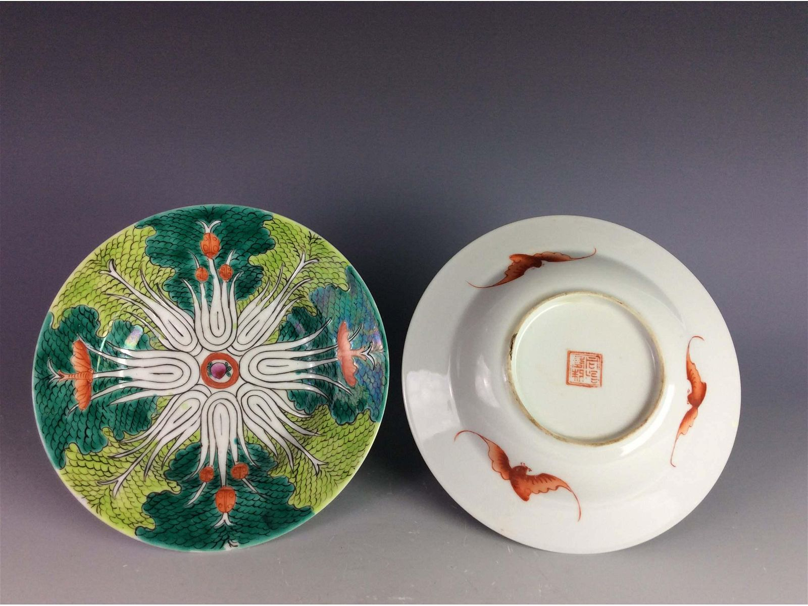 Pair of Chinese saucers both with mark on base.