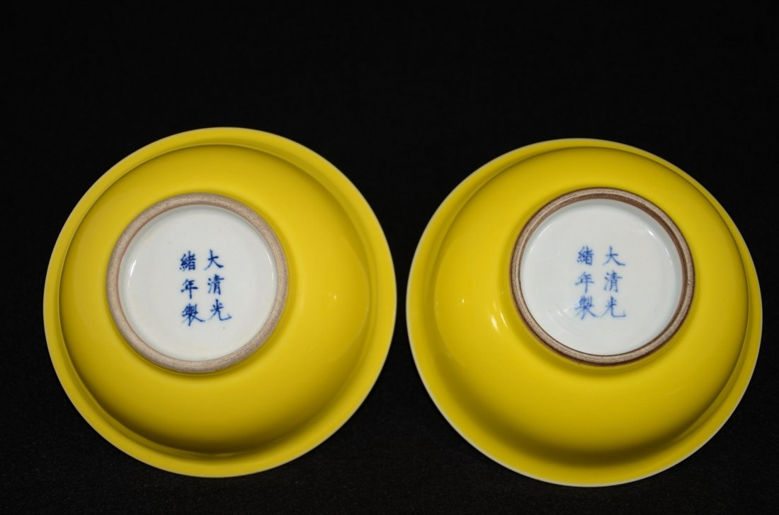 A pair of Chinese Guangxu marked yellow glazed bowl
