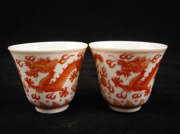 a pair of Chinese porcelain cups painted iron red