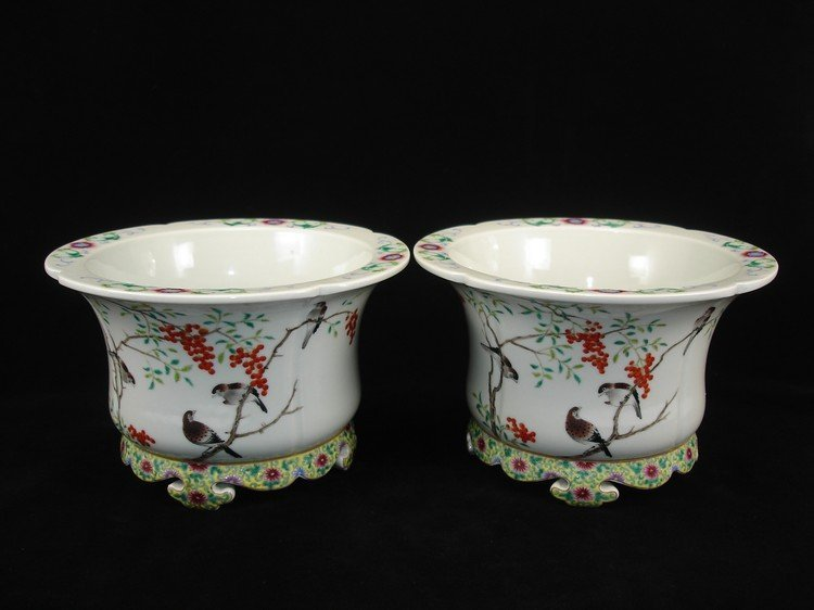 pair of famille rose enameled footed jardinières