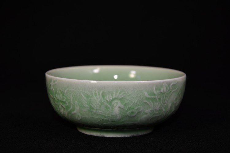 Chinese celadon bowl with mandarin ducks and lotus pond