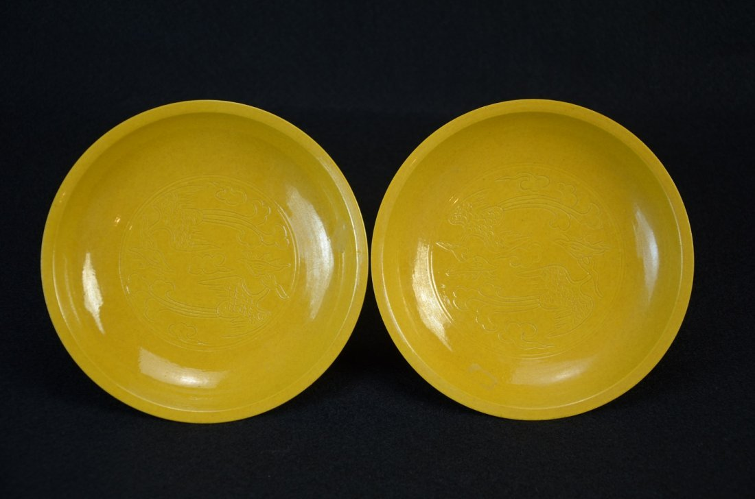 Pair of Chinese yellow glaze saucers