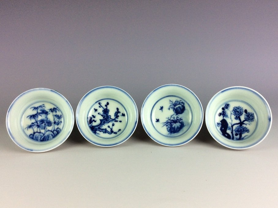 A set of 4 Chinese porcelain cups,  inside with blue & - 2