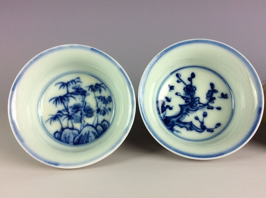 A set of 4 Chinese porcelain cups,  inside with blue & - 5