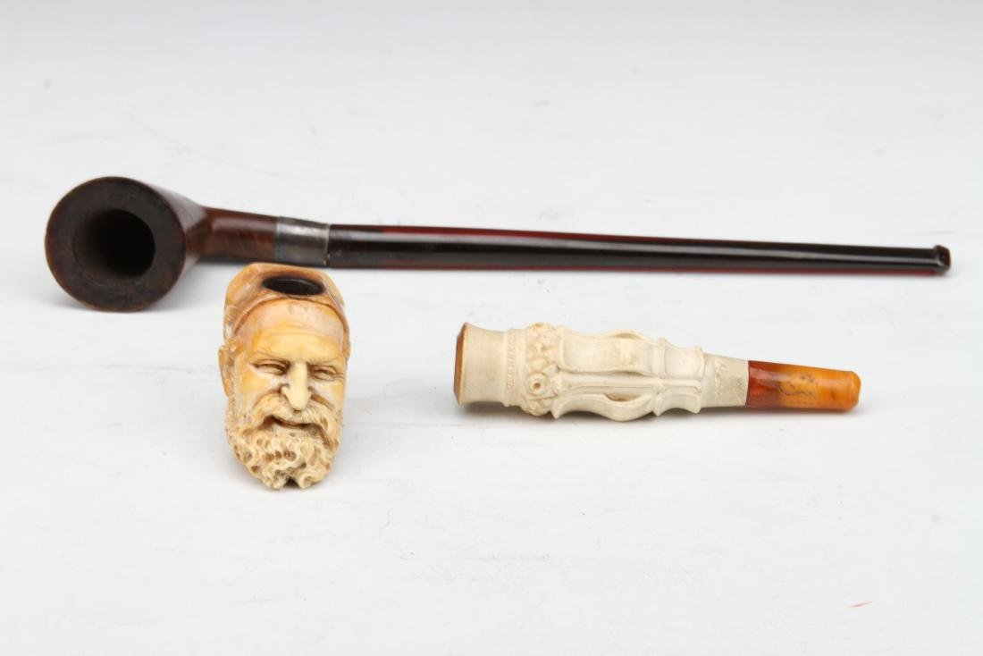 A SET OF HIGH END CRAFTS PIPES AND PIPE HEADS MADE IN