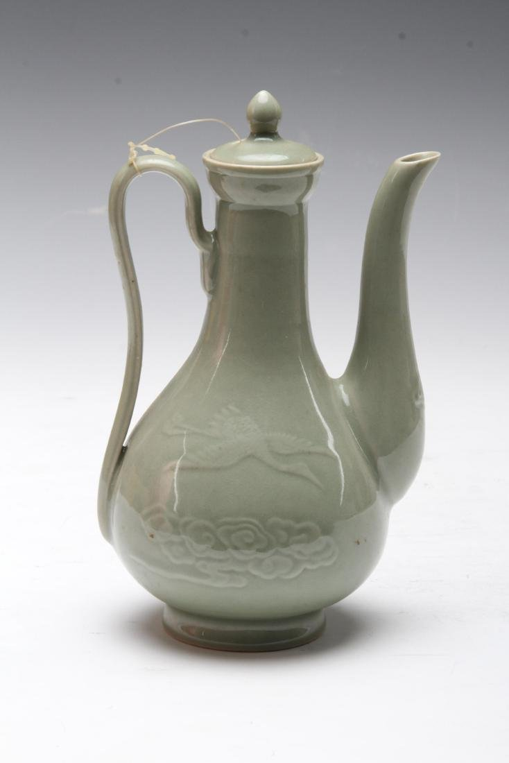 [CHINESE]A PORCELAIN WINE BOTTLE CARVED WITH CRANES AND