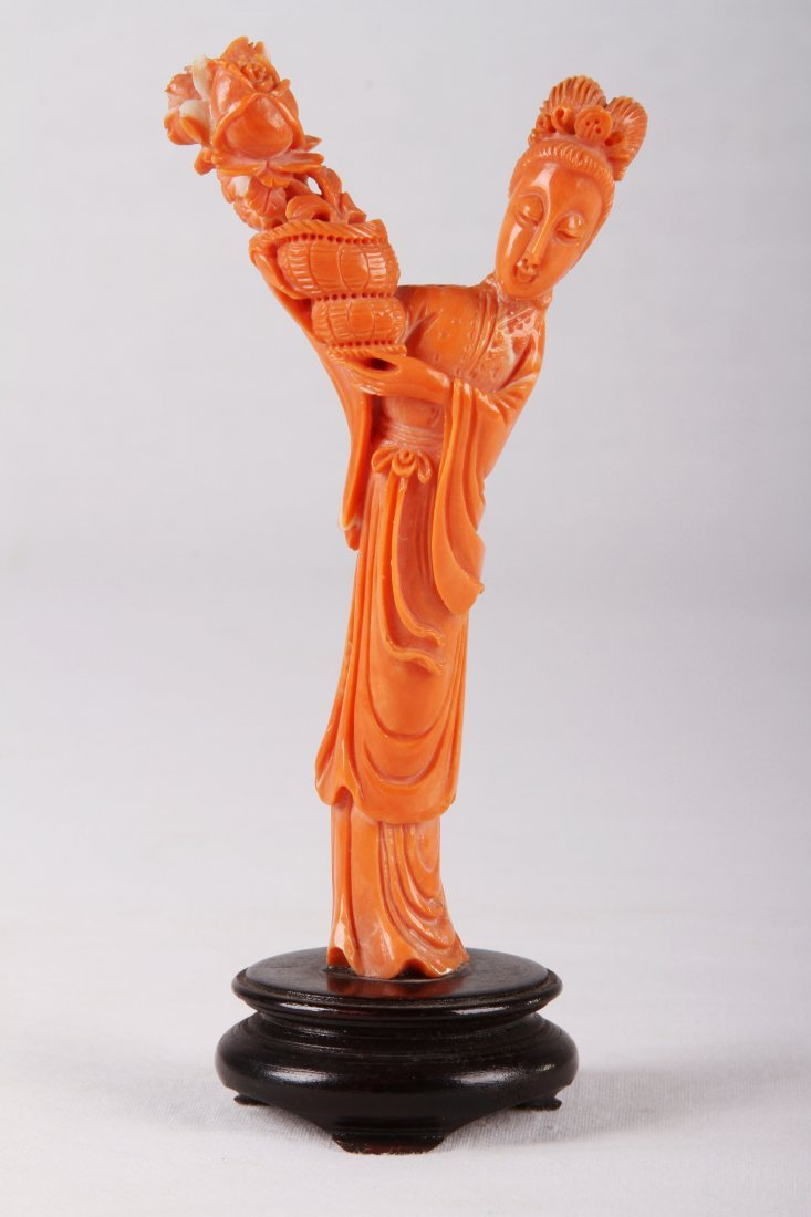[CHINESE] LATE 19TH CENTURY CORAL CARVING LADY HOLDING