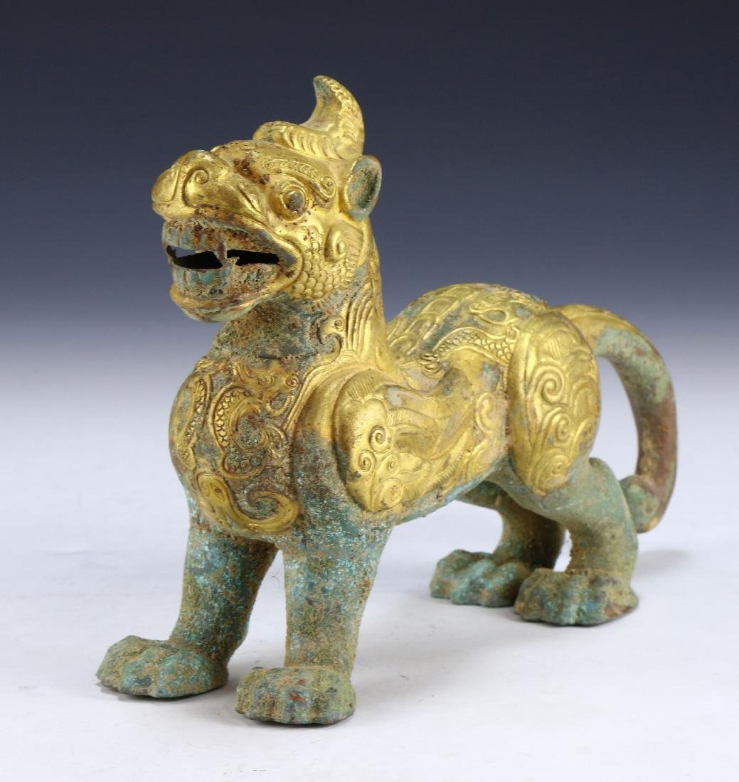 A CHINESE ANTIQUE GILT BRONZE LION DOG