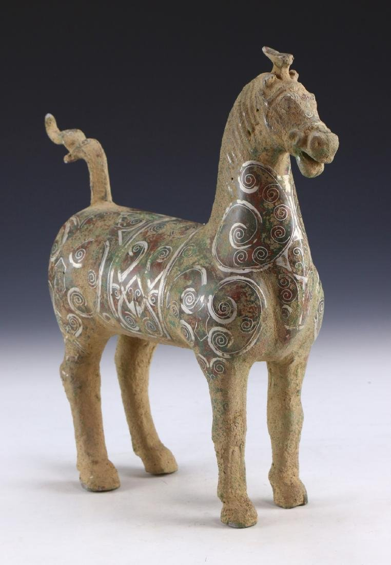 A LARGE ARCHAIC GOLD & SILVER-INLAID BRONZE HORSE