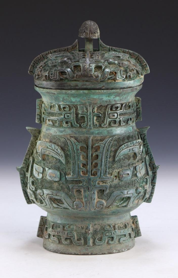 A CHINESE ARCHAIC BRONZE RITURAL VESSEL YOU