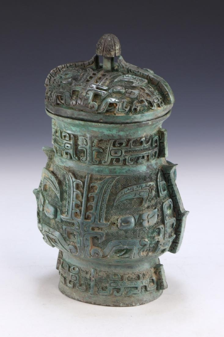 A CHINESE ARCHAIC BRONZE RITURAL VESSEL YOU - 2