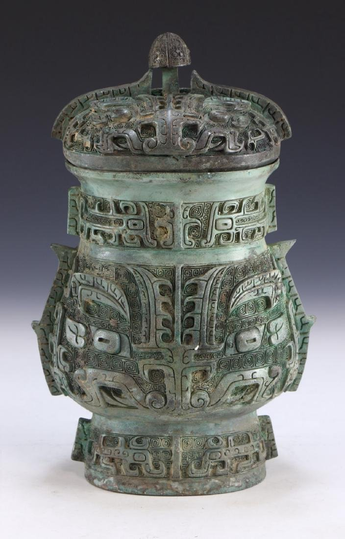 A CHINESE ARCHAIC BRONZE RITURAL VESSEL YOU - 3