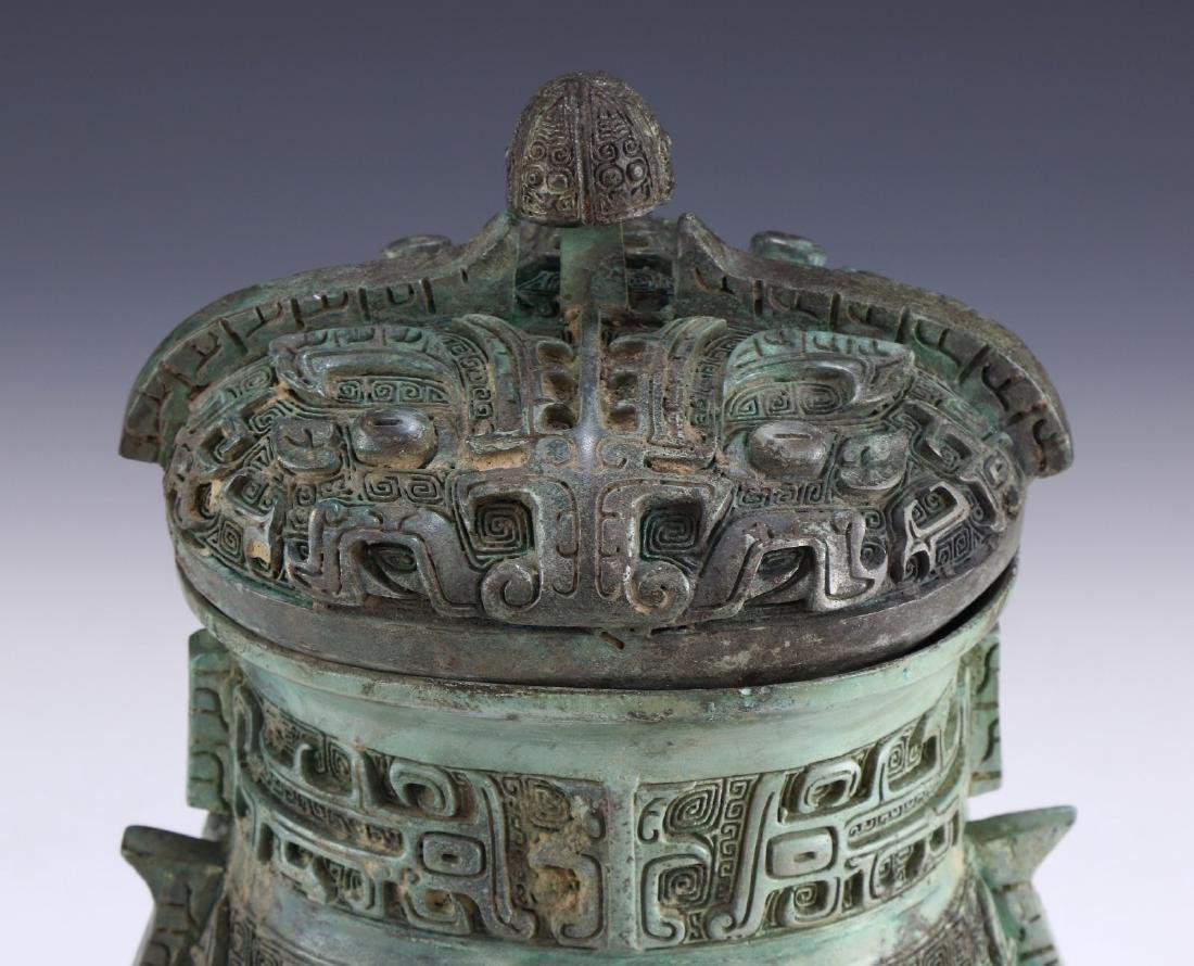 A CHINESE ARCHAIC BRONZE RITURAL VESSEL YOU - 4