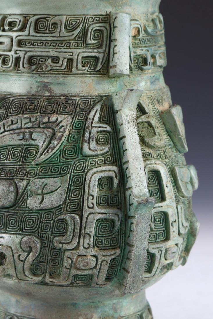 A CHINESE ARCHAIC BRONZE RITURAL VESSEL YOU - 6