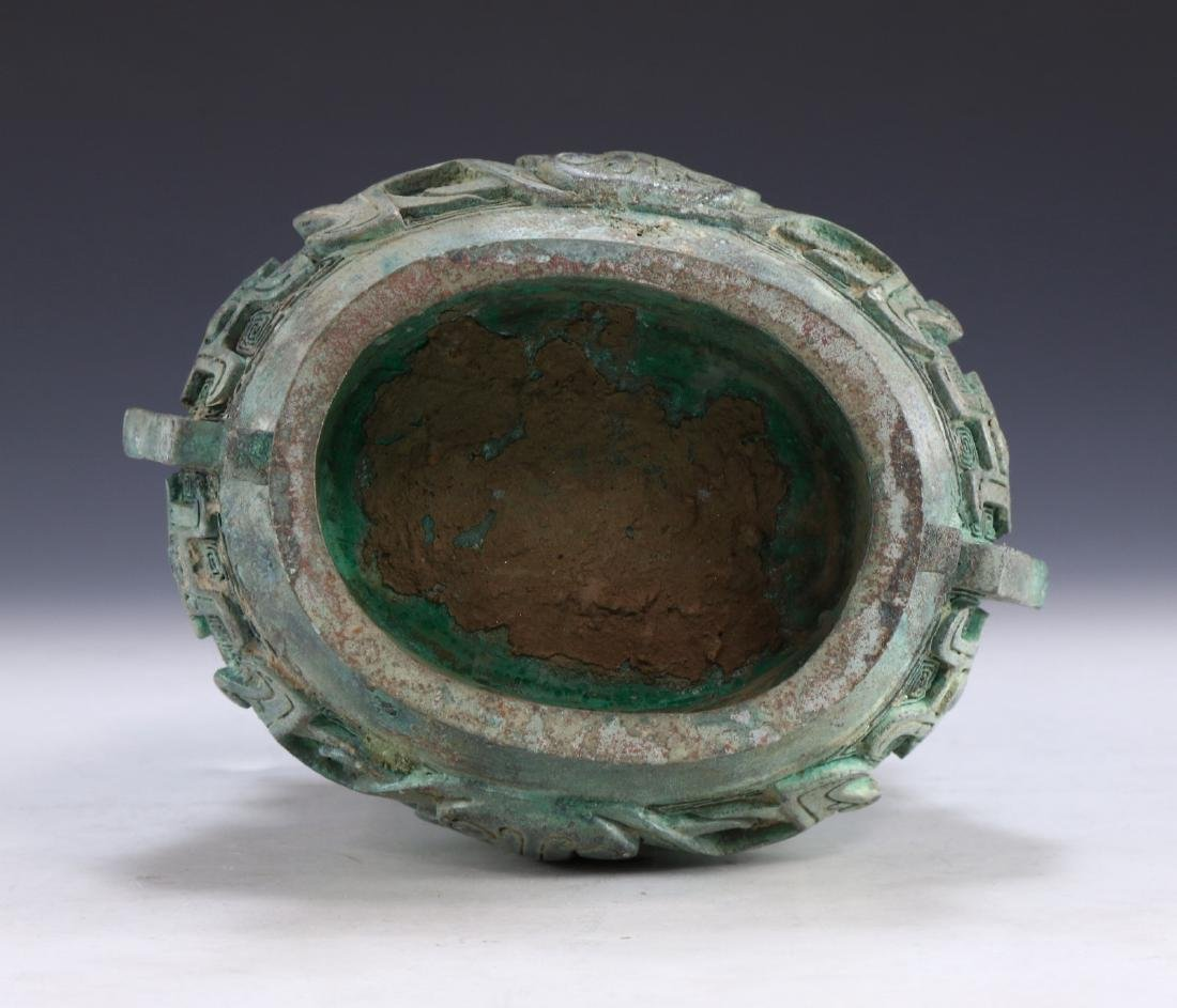 A CHINESE ARCHAIC BRONZE RITURAL VESSEL YOU - 7