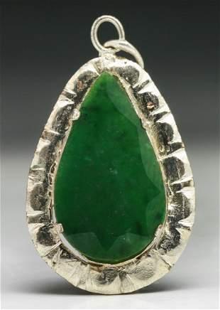 A Translucent Green Jadeite Pendant