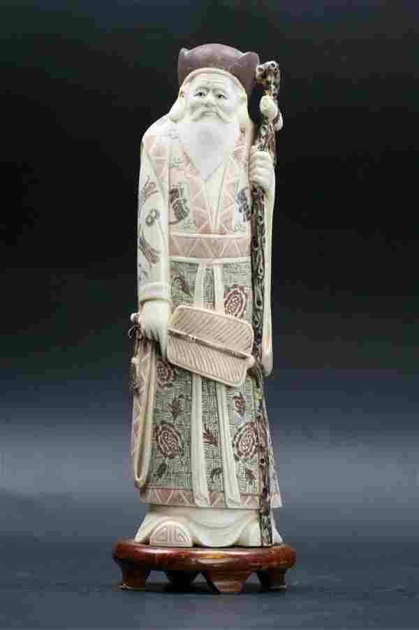 A Japanese Polychrome Ivory Okimono: Figure