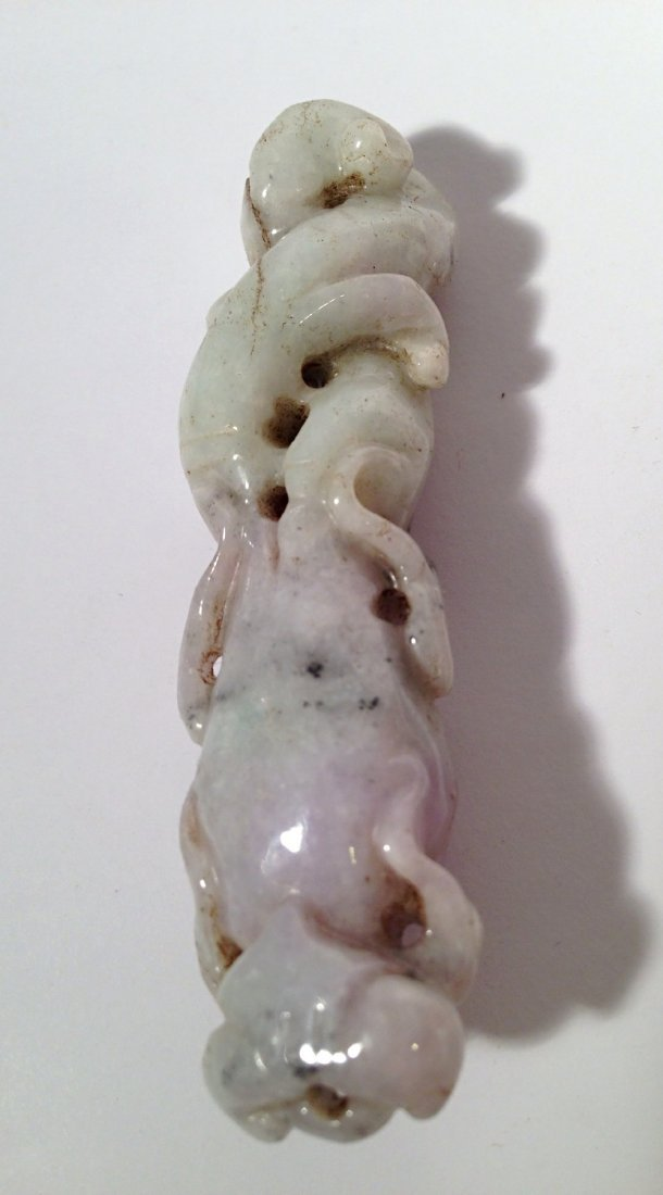 Carved light purple jade pendant