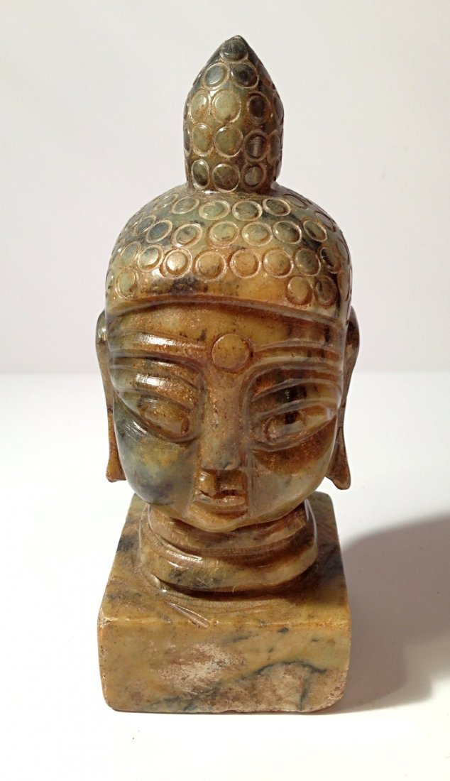 Carved jade stamp with Buddha head