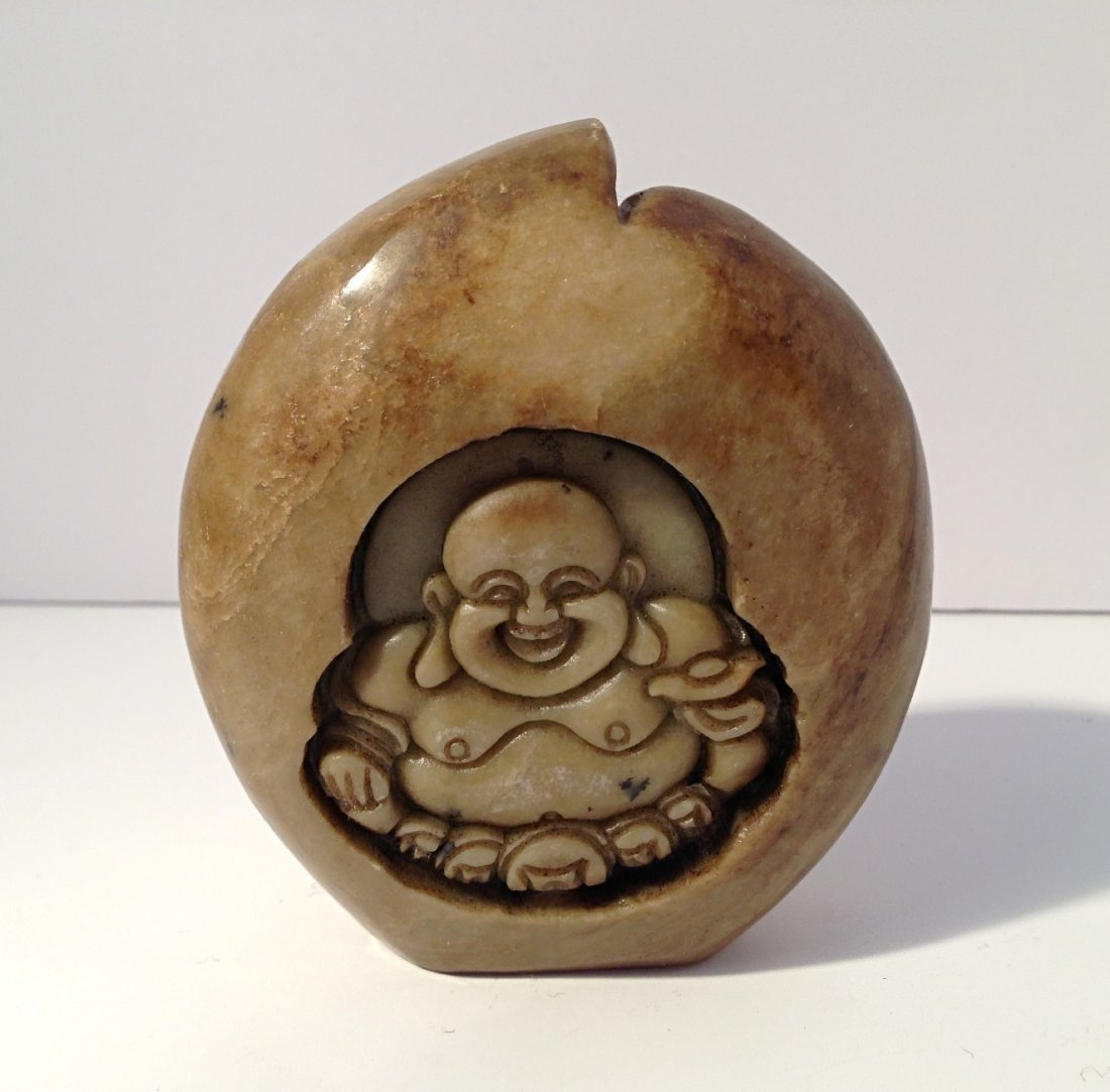 Peach shaped soapstone carving with smiling Buddha