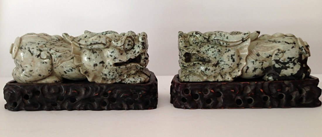 Pair of jadeite foo dogs with wood stand