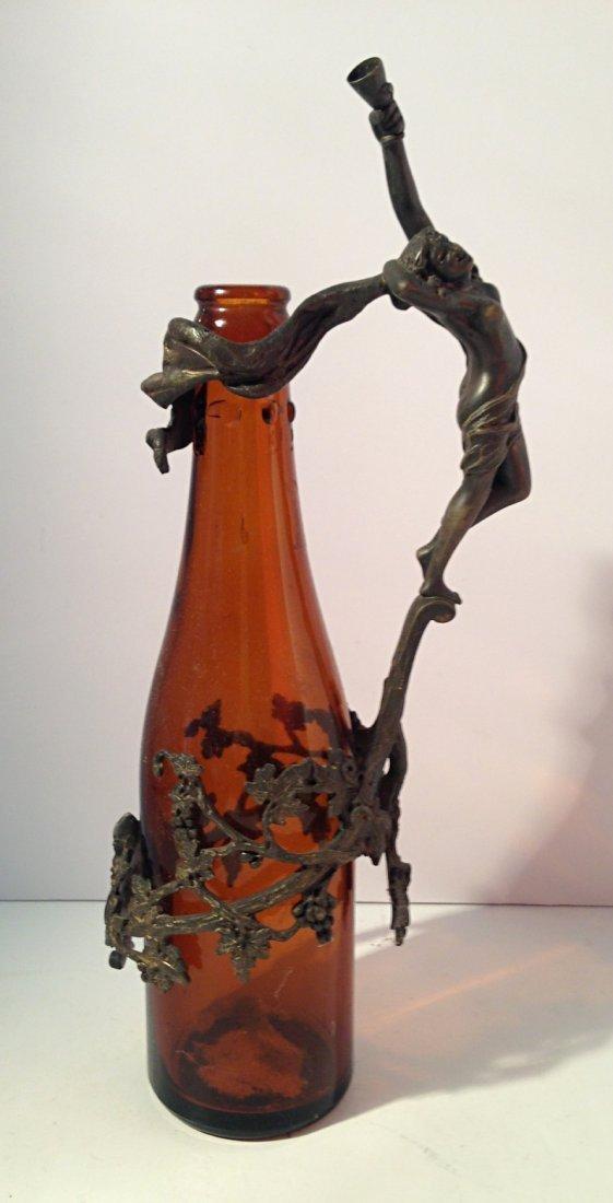 Brown glass with bronze statue around