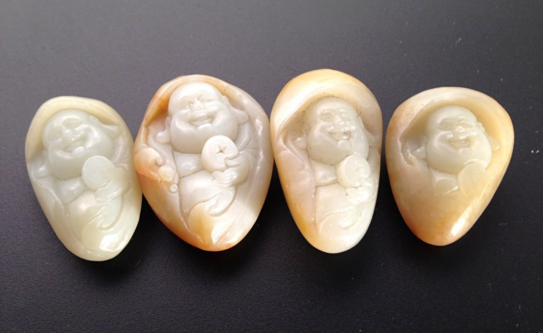 Group of carved jade with smiling Buddha