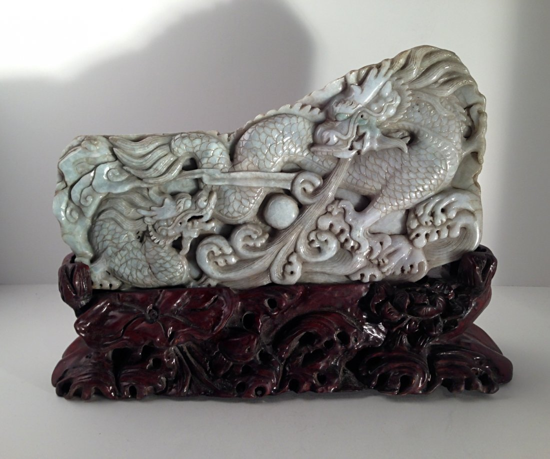 Carved jadeite dragon with wood stand