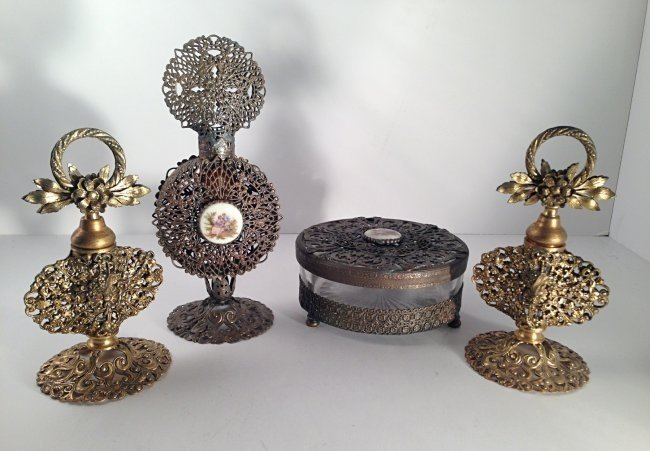 Group of brass perfume bottles and box