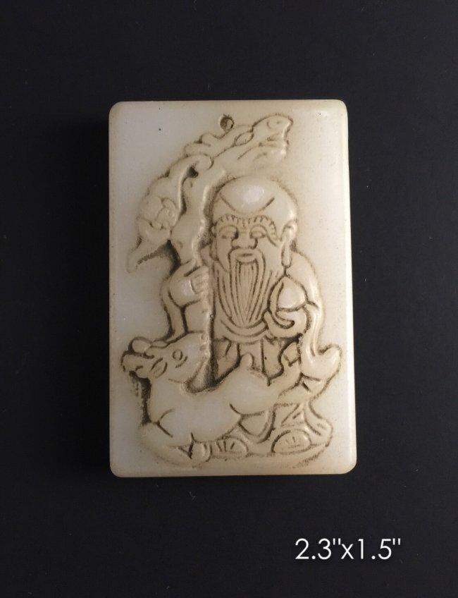 Carved white pendant
