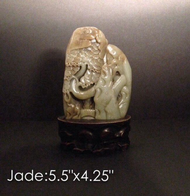 Carved jade with wood base