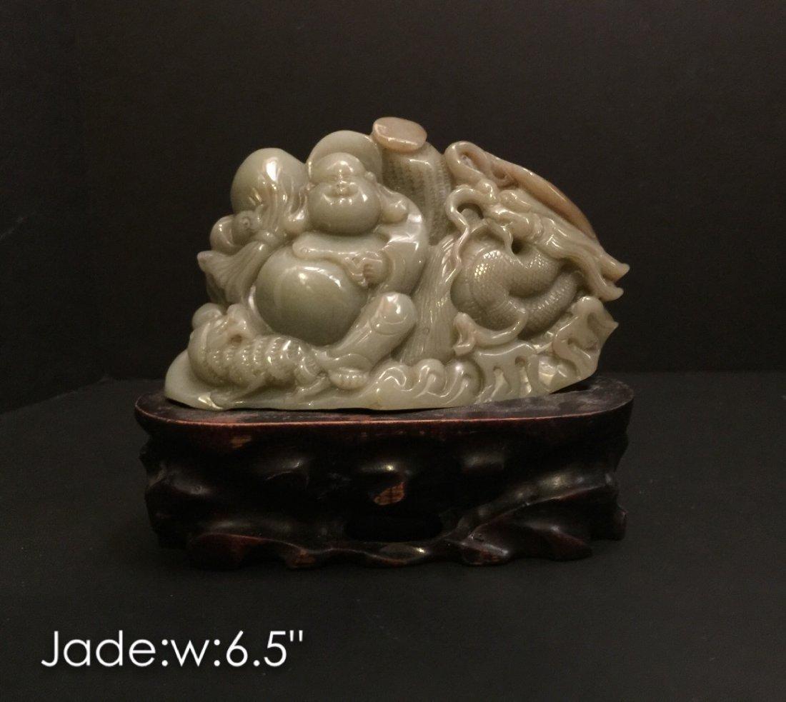 Carved he tian jade Buddha with wood base