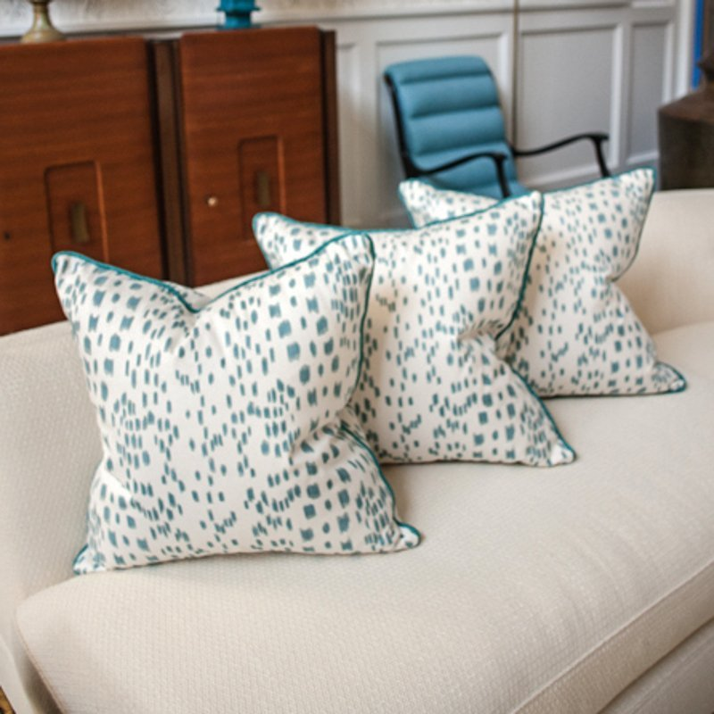 "Three 20"" square pillows of turqouise and white linen"