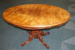 Victorian walnut tilt-top table on bulbous carved under