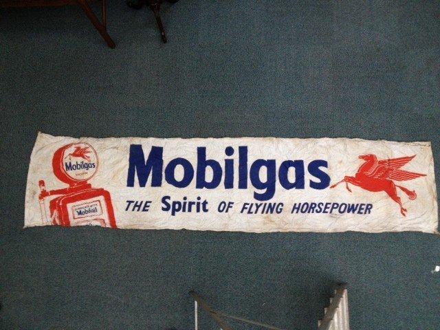 A large Mobiloil banner,'The Spirit of Flying Horse pow