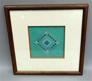ANTIQUE FRAMED QUILT