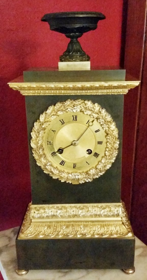 ANTIQUE BRONZE EMPIRE MANTLE CLOCK WITH SOLK SUSPENSION