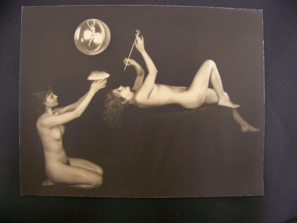 72: photograph of two nude women